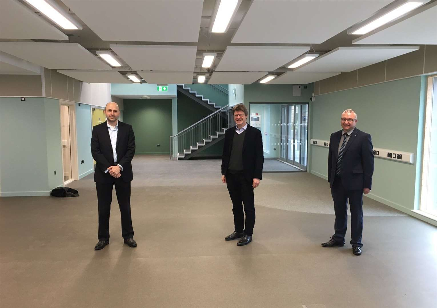 Jonathan White, Greg Clark and James Pearson, the head of KCC Libraries, Registration and Archives, in the main library space at the new civic centre in Southborough