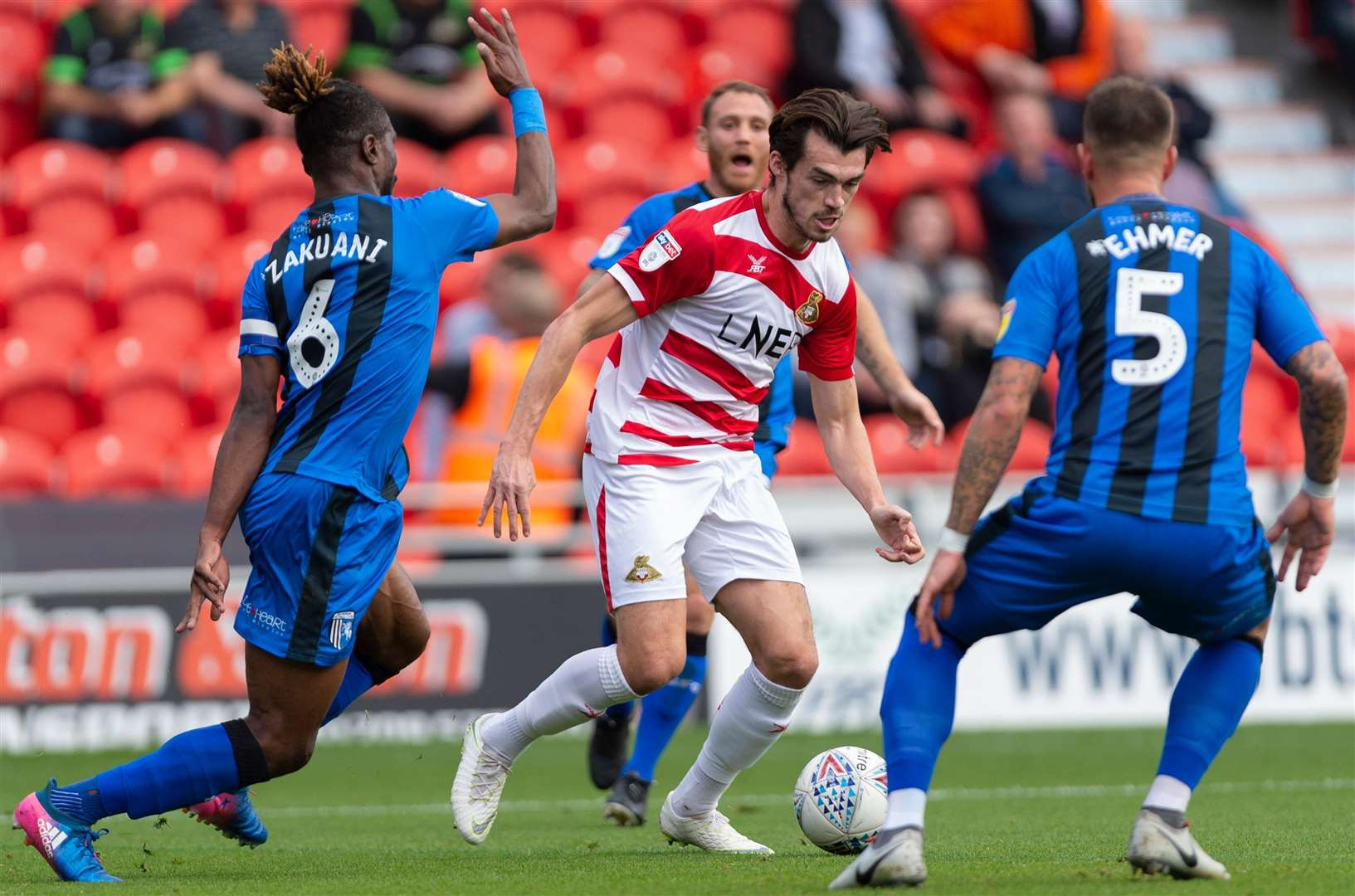 Former Gills forward John Marquis takes on the visiting defence. Picture: Ady Kerry