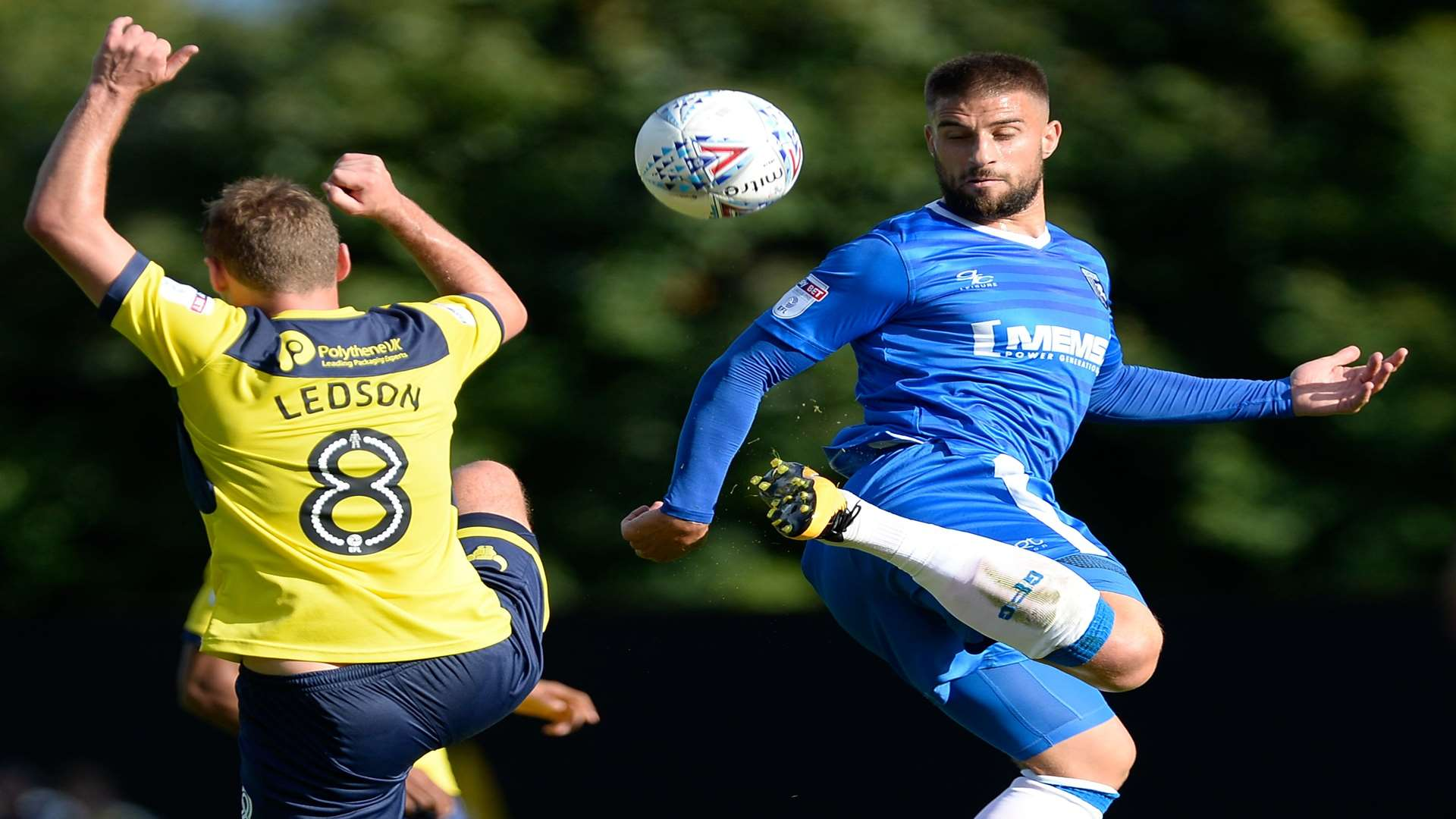 Gillingham's Max Ehmer shows a deft touch in front of Oxford's Ryan Ledson. Picture: Ady Kerry