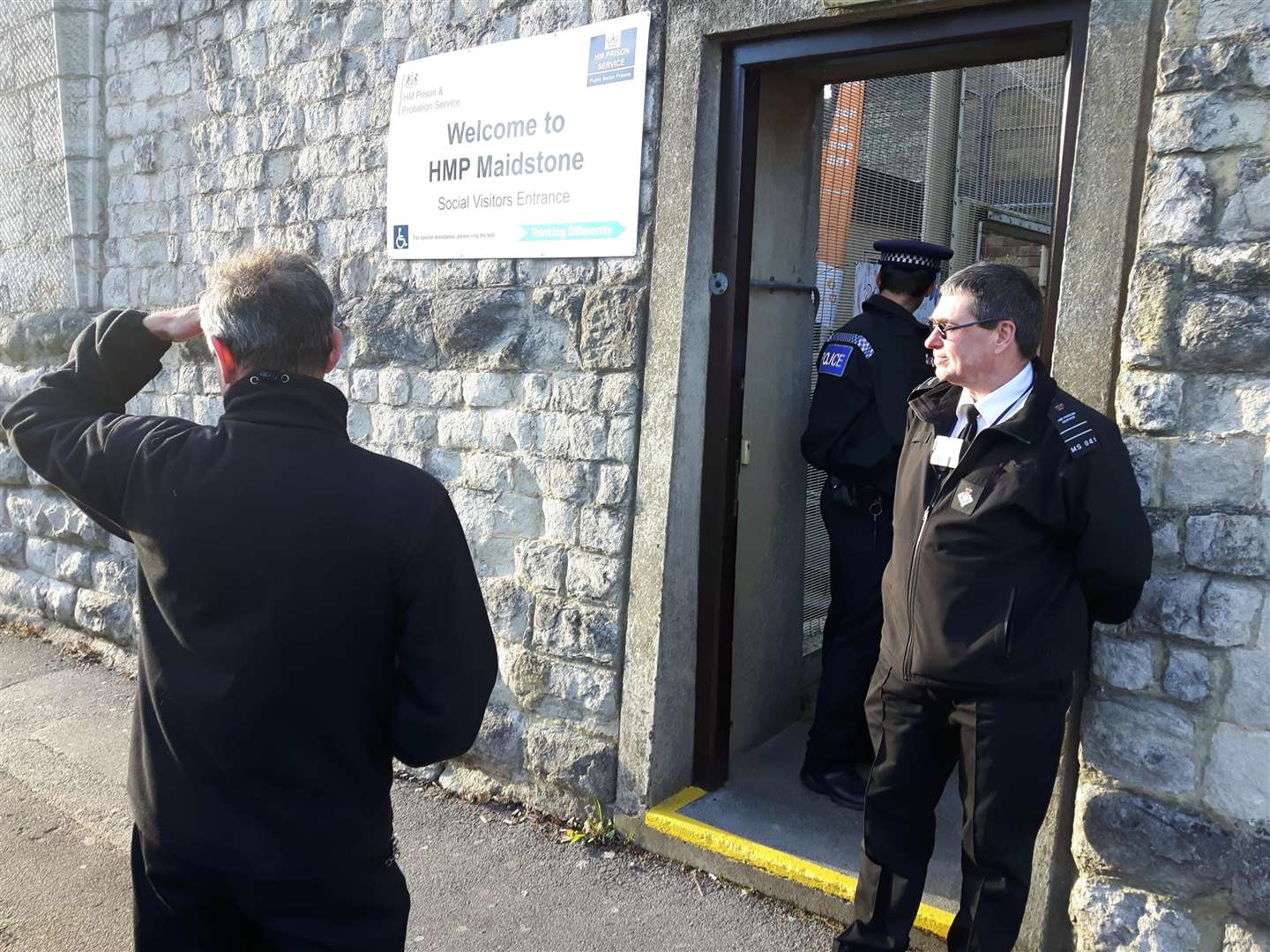 Police and prison officers outside the prison