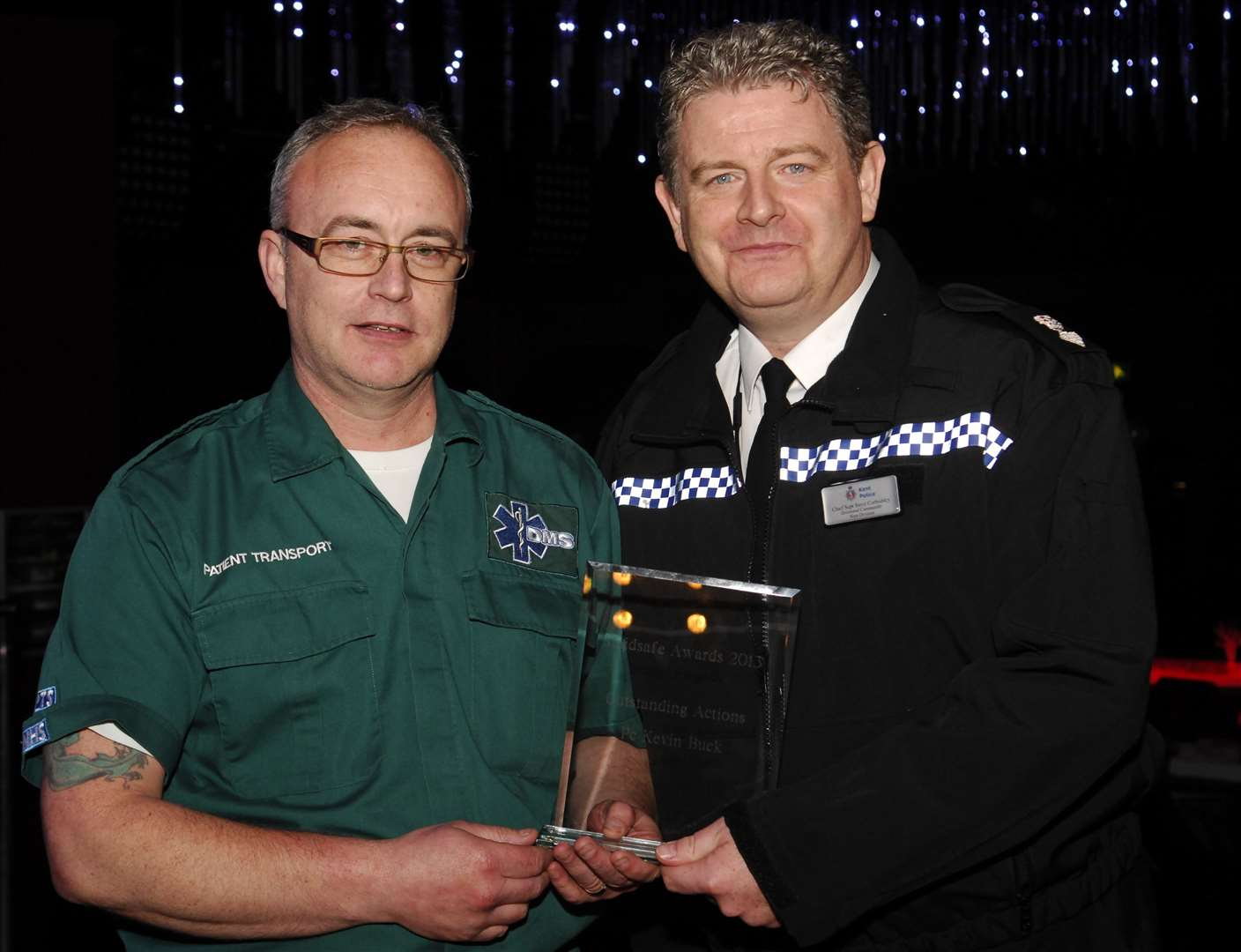 Kevin Buck getting his award from former Chief Supt Corbishley at the Maidsafe Awards Evening in 2014