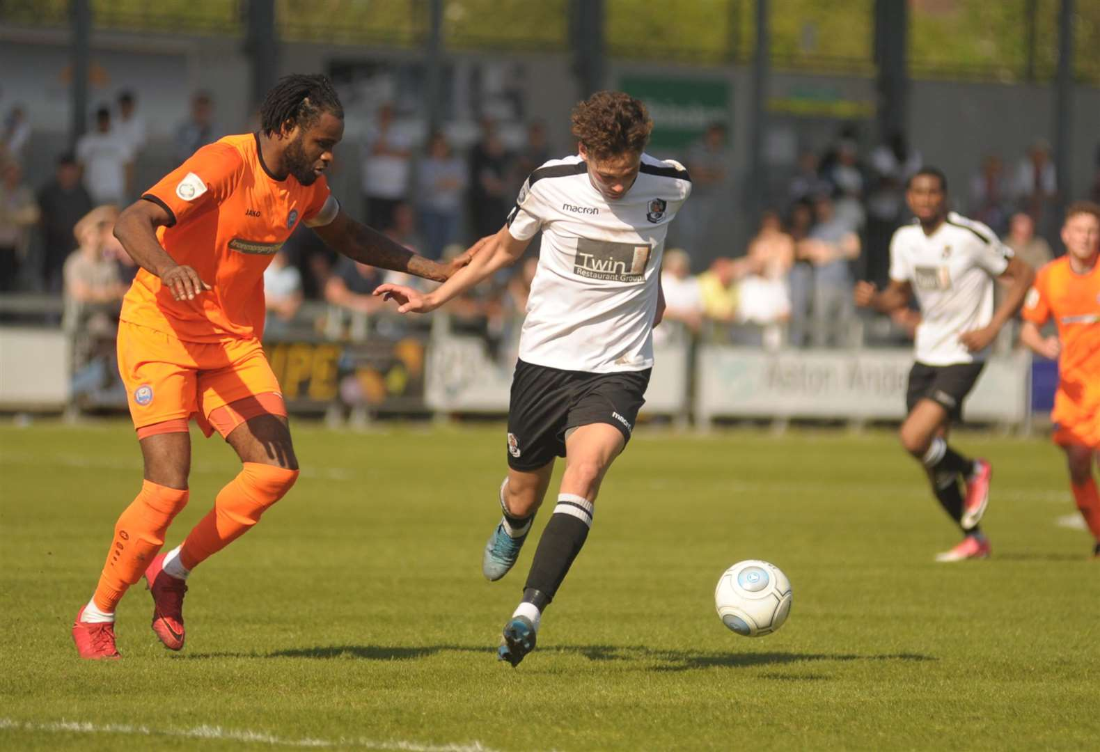 Alfie Pavey up against Braintree captain Marc-Anthony Okoye in the play-off semi-final Picture: Steve Crispe
