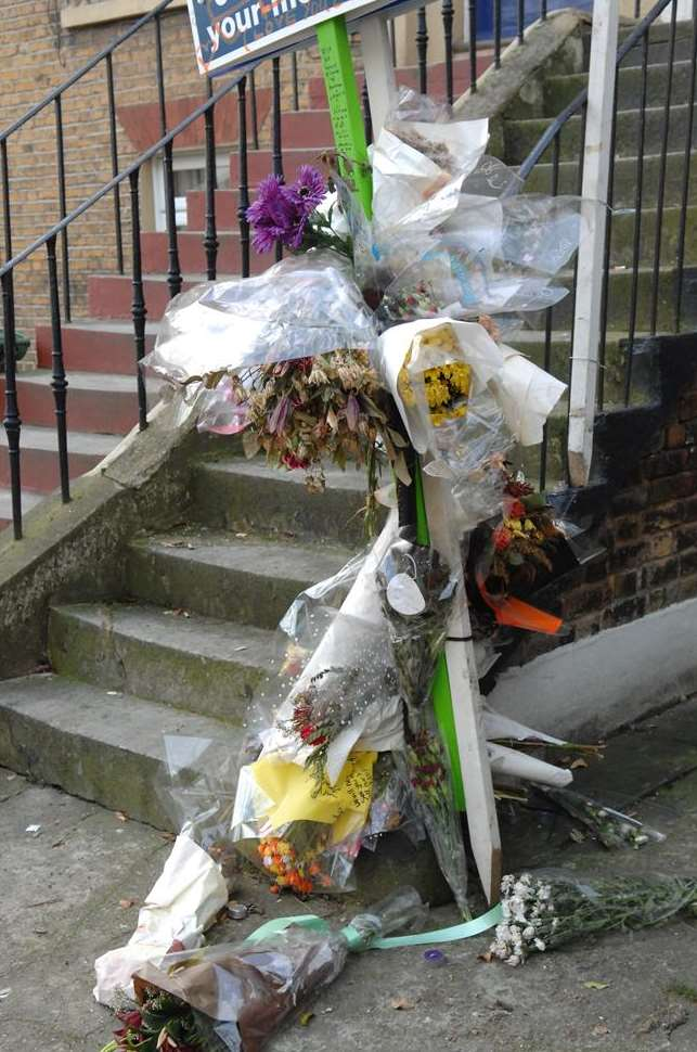 Floral tributes outside the flat in Parrock Street, Gravesend, where Edward Barry died