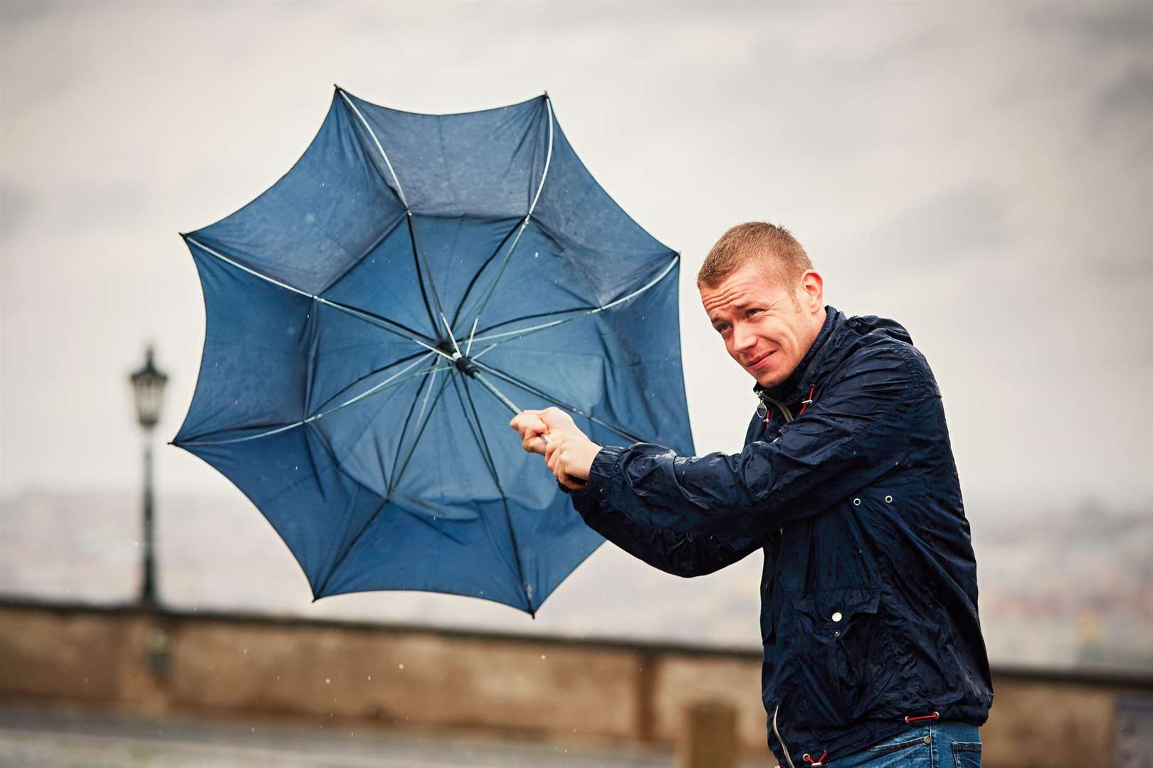 Umbrellas could be ruined later as strong winds hit Kent. Stock image