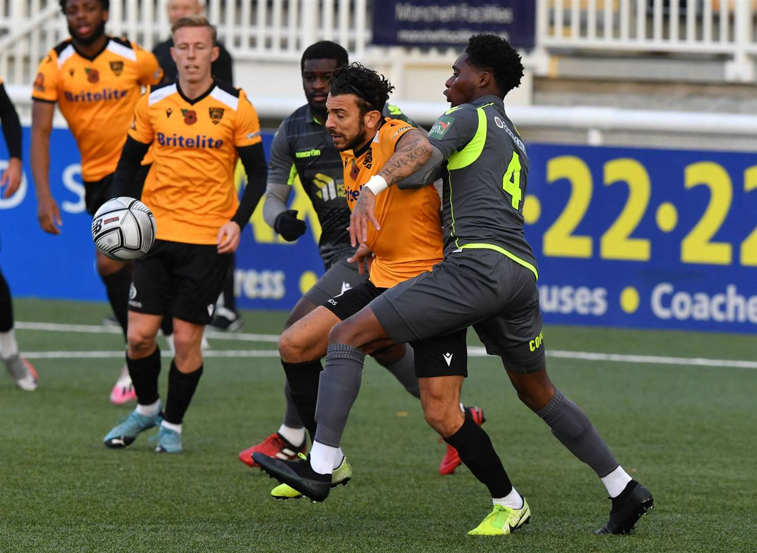 George Porter tries to find a way past ex-Maidstone man Jordan Wynter Picture: Keith Gillard