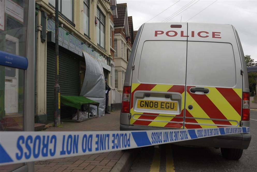 A cordon outside Sani Globe food store in Luton Road