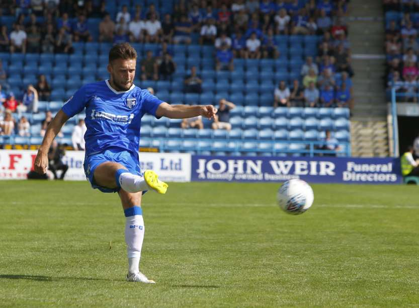 Luke O'Neill puts in a cross for Gillingham Picture: Andy Jones