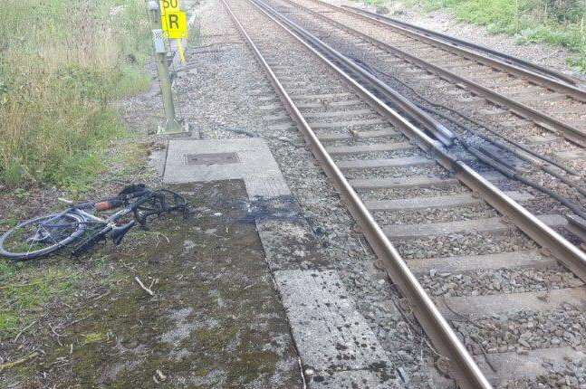 This was the scene after a man's bike was wheeled over train tracks and caught fire. Picture courtesy: British Transport Police Kent