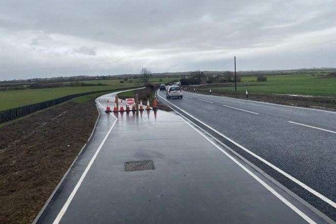 The new cycle path along the Lower Road in Minster is closed because it is flooded. Picture: Adam Baker