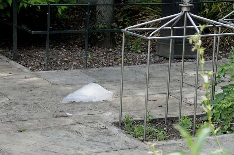 A plastic bag covers evidence in Canterbury's Dane John Gardens