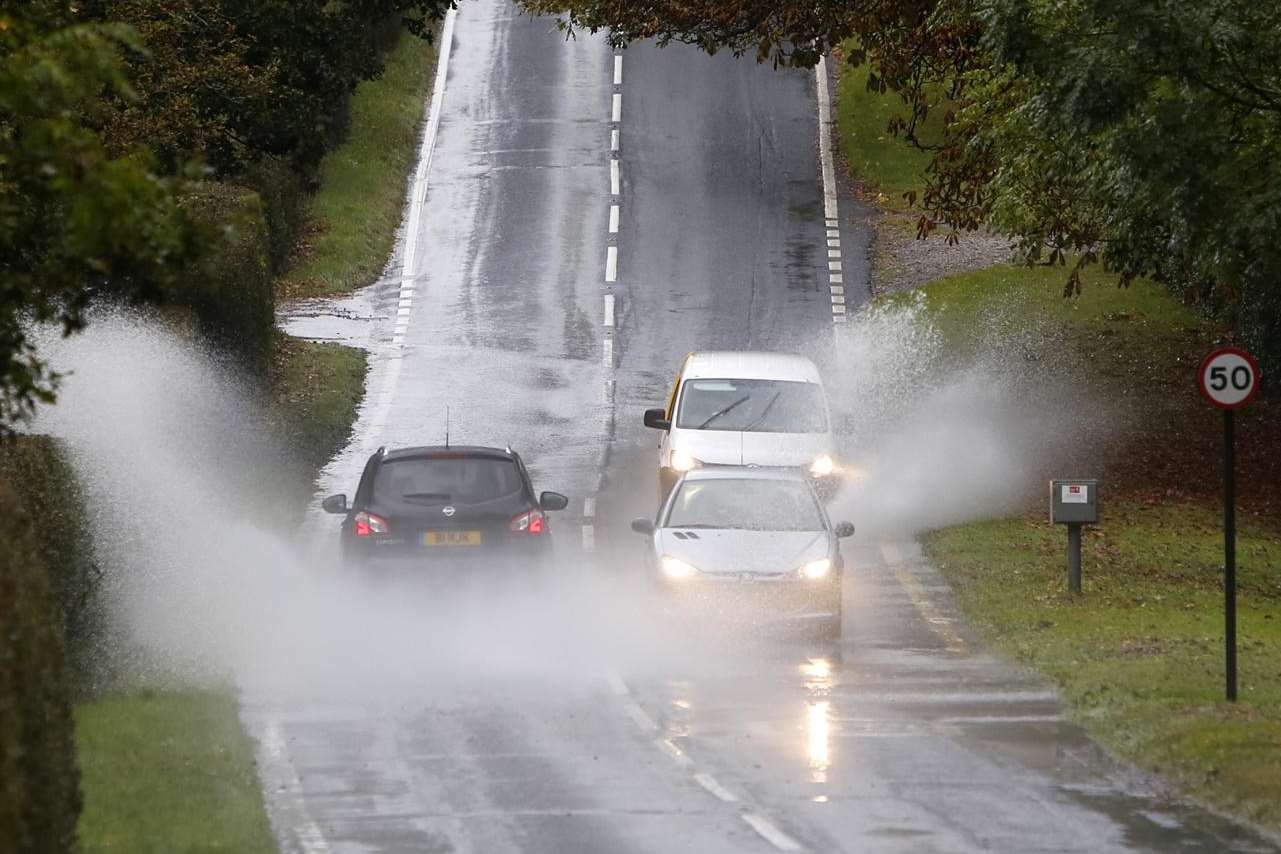 Drivers wade through surface water on the A227 at Shipbourne,