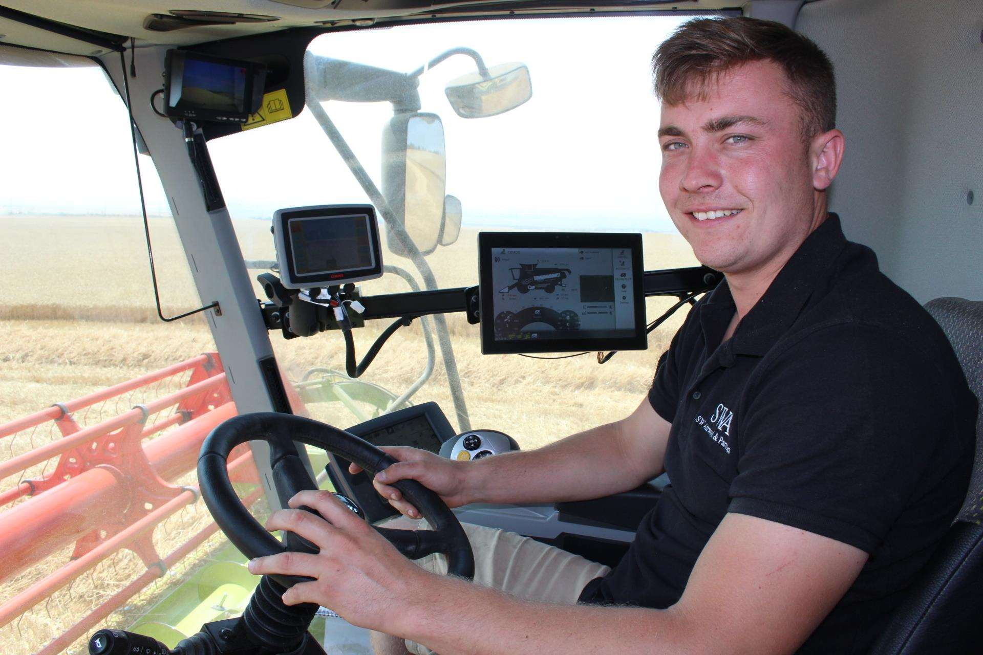 Harvesting time on the Isle of Sheppey with farmer James Attwood of SW Attwood and Partners in the cab of his state-of-the-art £400,000 combine harvester (3297695)