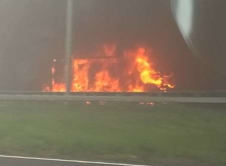 The lorry engulfed in flames. Picture: Sophie Child.