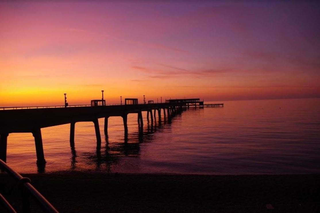 Take a romantic stroll along Deal pier as the sun sets