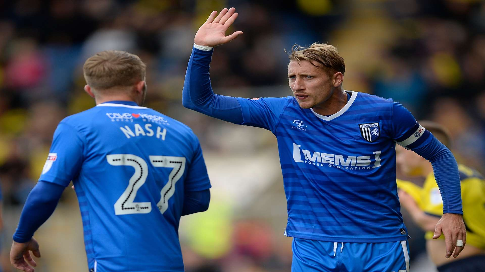 Gillingham captain Lee Martin has a difference of opinion with Liam Nash. Picture: Ady Kerry