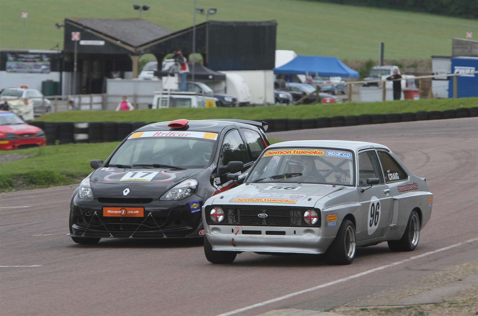 Elham area residents Nigel Craig (right) and Tony Skelton battle it out at Lydden in 2012. The landmark 'Y' roof of the former scrutineering bay can be seen in the background. Picture: Kerry Dunlop
