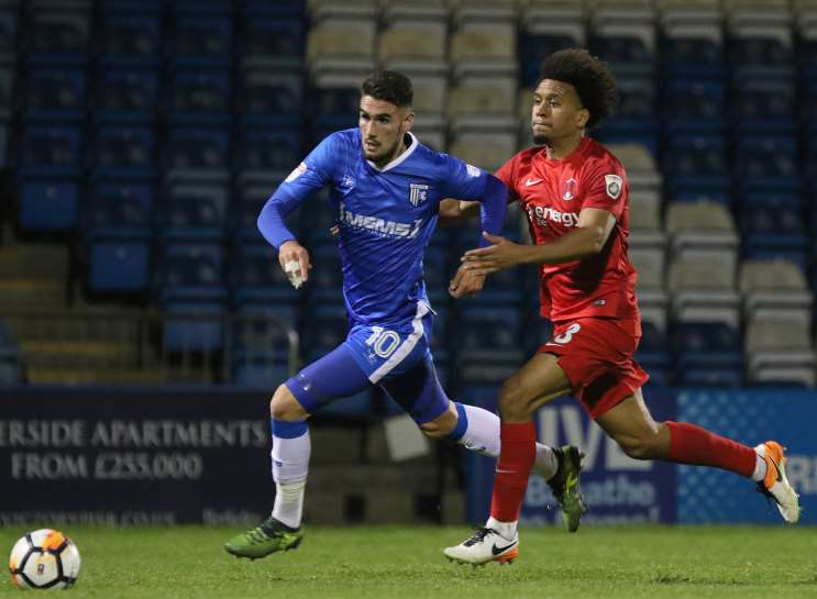 Gills' Conor Wilkinson is pulled back by Orient's Joe Widdowson, who collected his second yellow card. Picture: Andy Jones