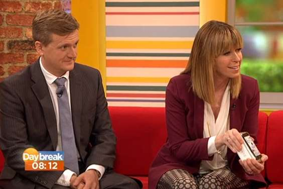 Daybreak presenter Kate Garraway, pictured with co-host Aled Jones, presents Ella Birchenough with a new iPhone. Picture: ITV/Daybreak