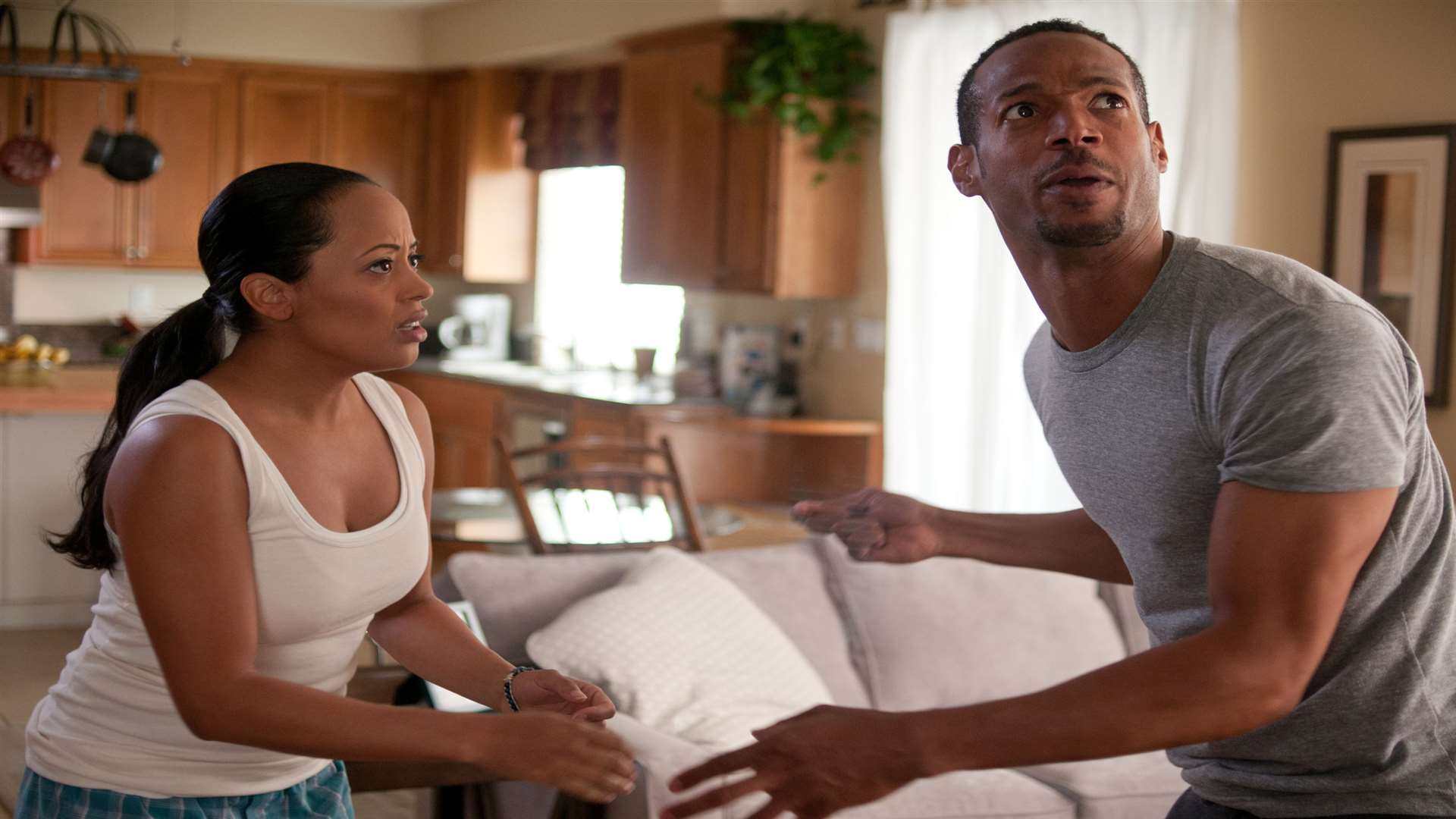 Marlon Wayans as Malcolm and Essence Atkins as Kisha in A Haunted House. Picture: PA Photo/Handout.