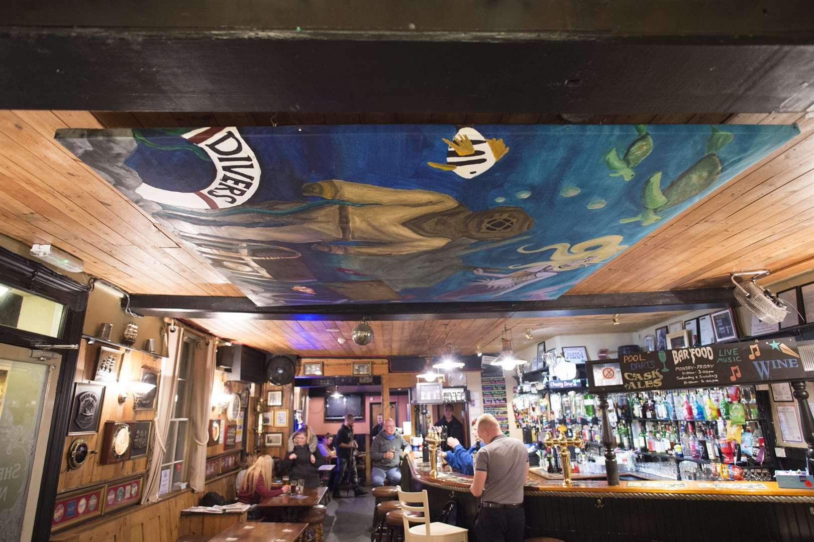 Divers Arms ocean mural suspends from the ceiling