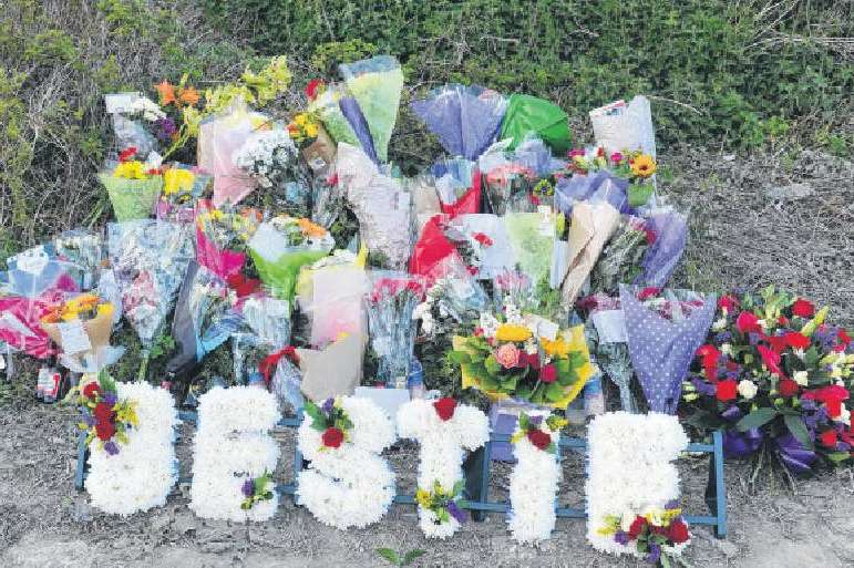 Floral tributes mount for David Rose