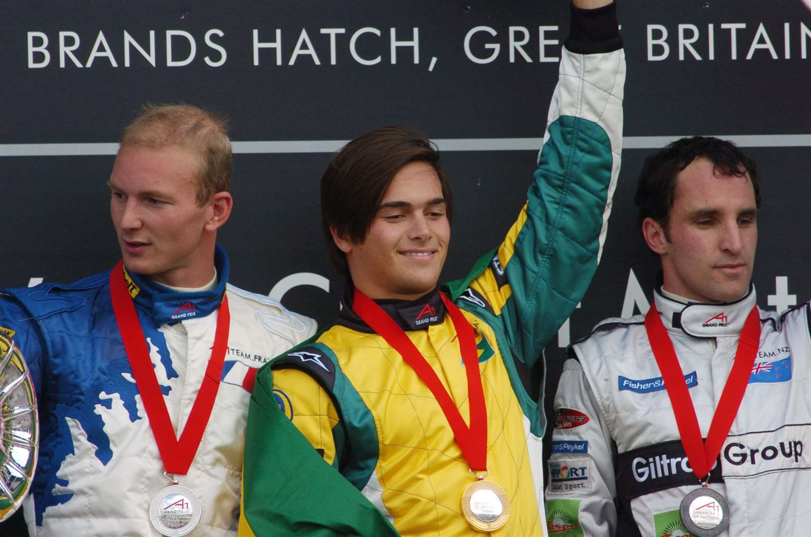 "Frenchman Alexandre Premat and New Zealand's Matt Halliday alongside race winner Nelson Piquet Jr in 2005. ""I'm not racing for myself but for my country – A1 is going to be huge,"" Piquet Jr said afterwards. Picture: Barry Goodwin"