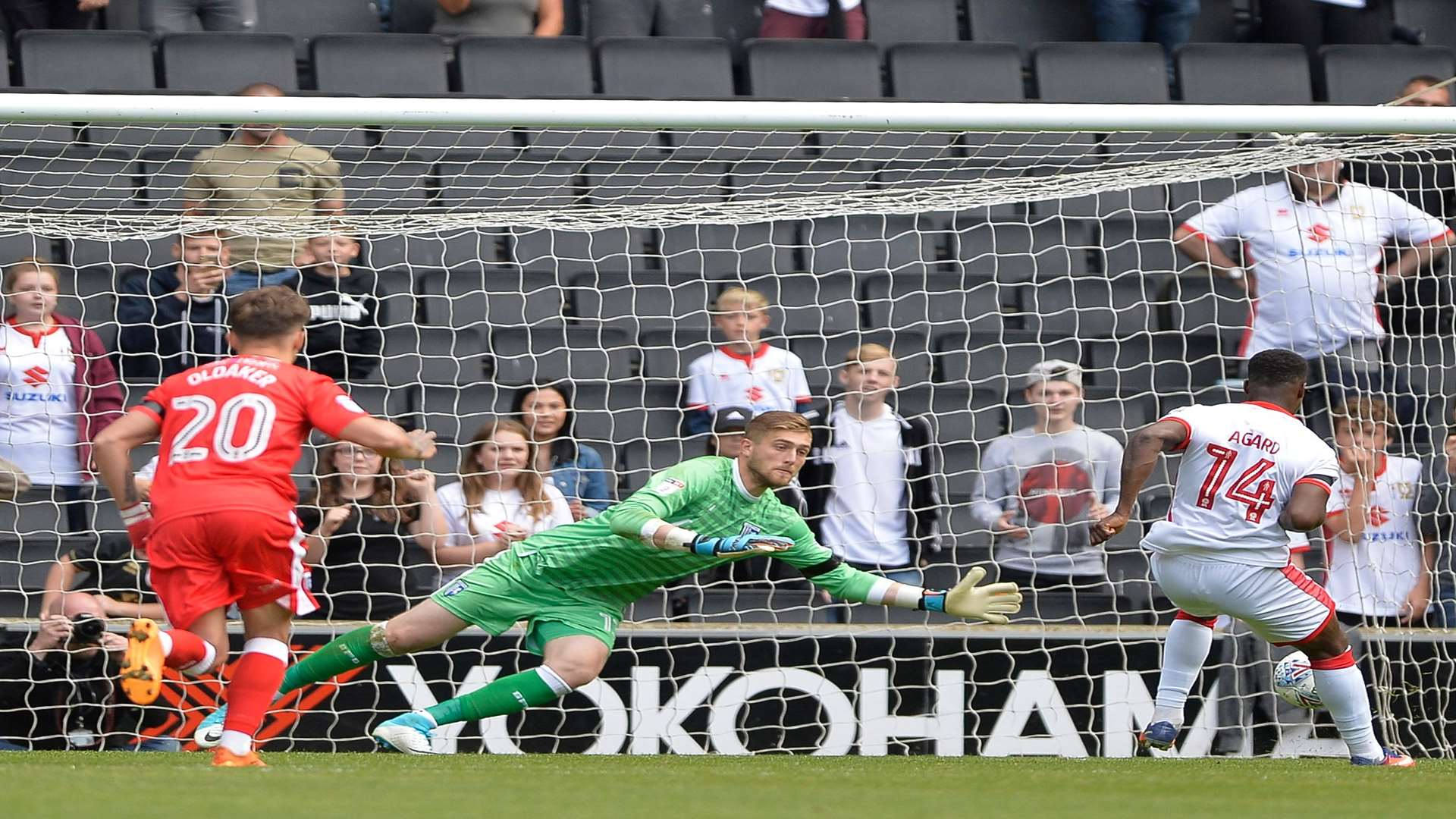 Gills keeper Tomas Holy saves a penalty against MK Dons. Picture: Ady Kerry