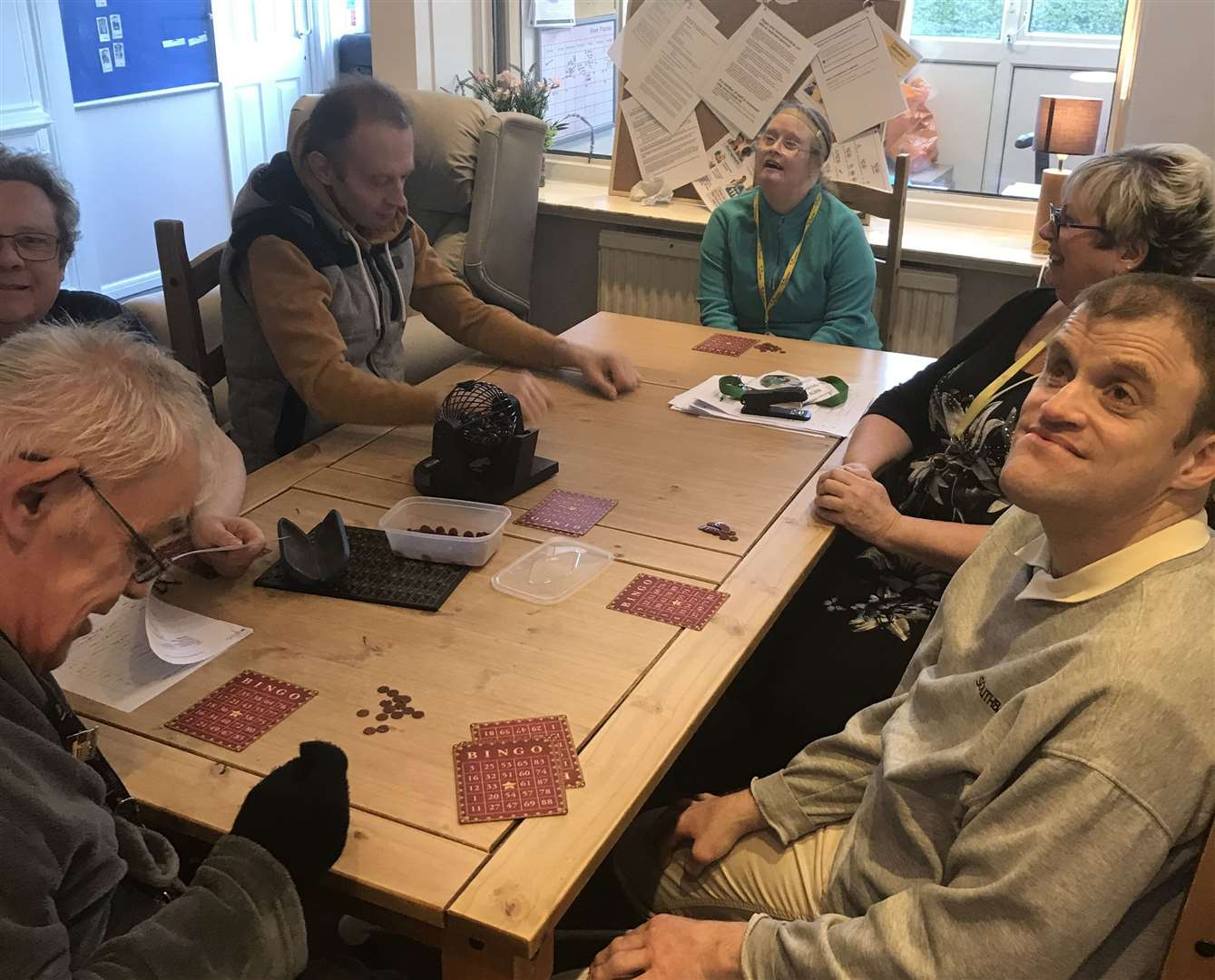 Service users play bingo inside as they adapt to a new routine