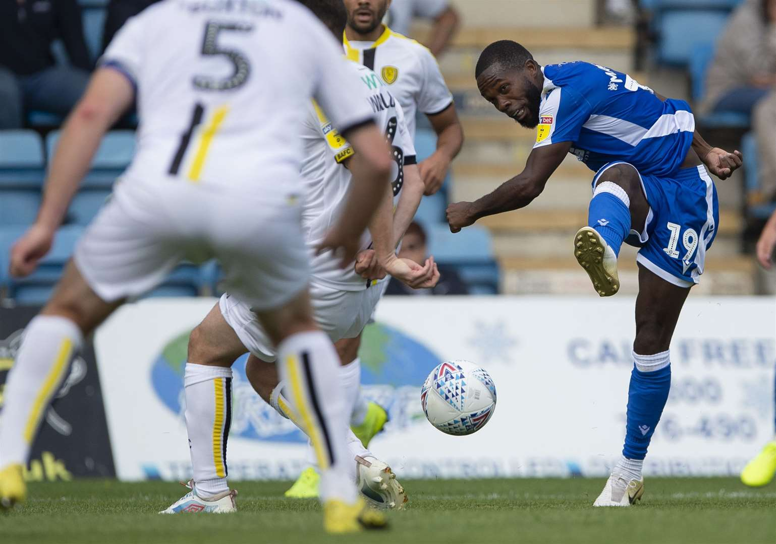 Gillingham winger Mark Marshall shoots through the massed ranks of the Burton defence Picture: Ady Kerry