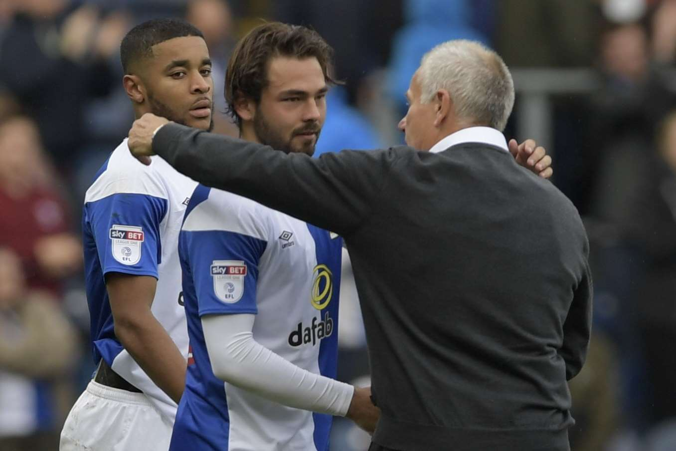 Interim Gills boss Peter Taylor hugs Bradley Dack at the final whistle Picture: Barry Goodwin