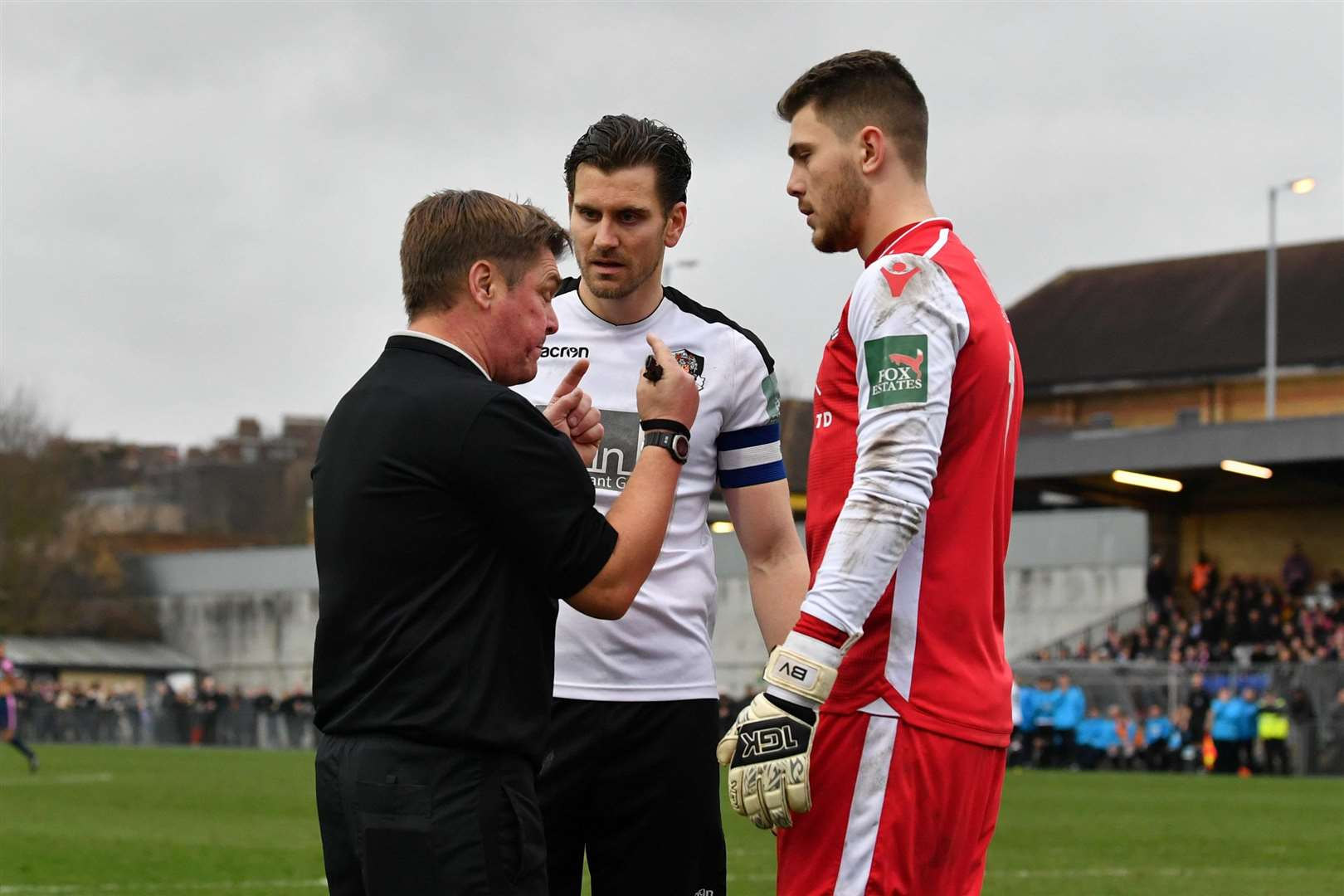 Referee David Spain talks to Tom Bonner and Bailey Vose Picture: Keith Gillard