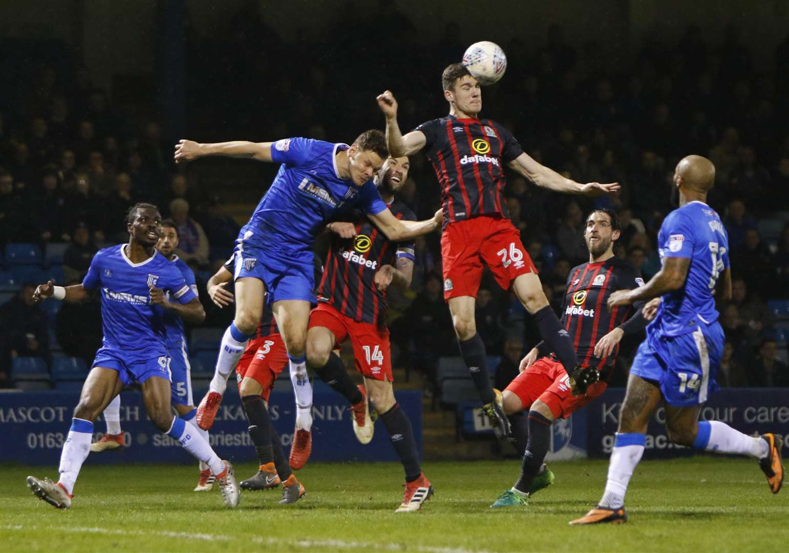 Blackburn defender Darragh Lenihan beats Gillingham defender Ben Nugent to the ball Picture: Andy Jones