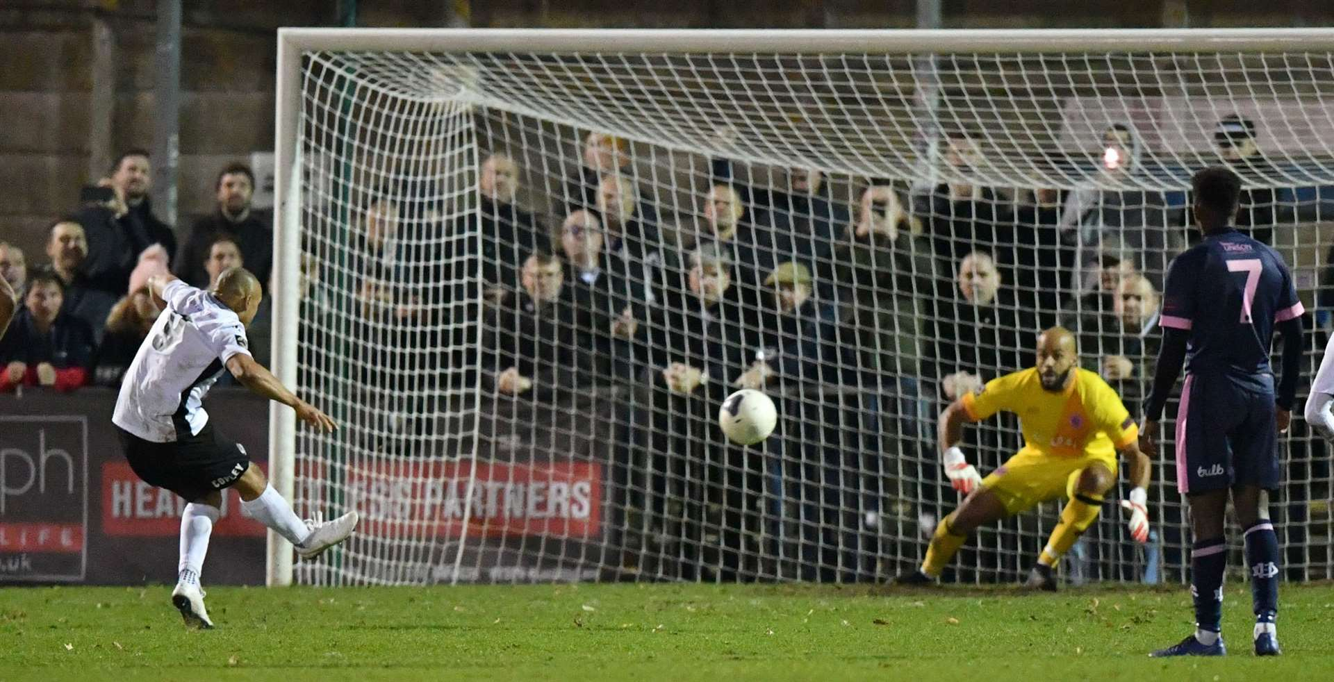 Elliott Romain converts from the penalty spot for Dartford at Dulwich. Picture: Keith Gillard