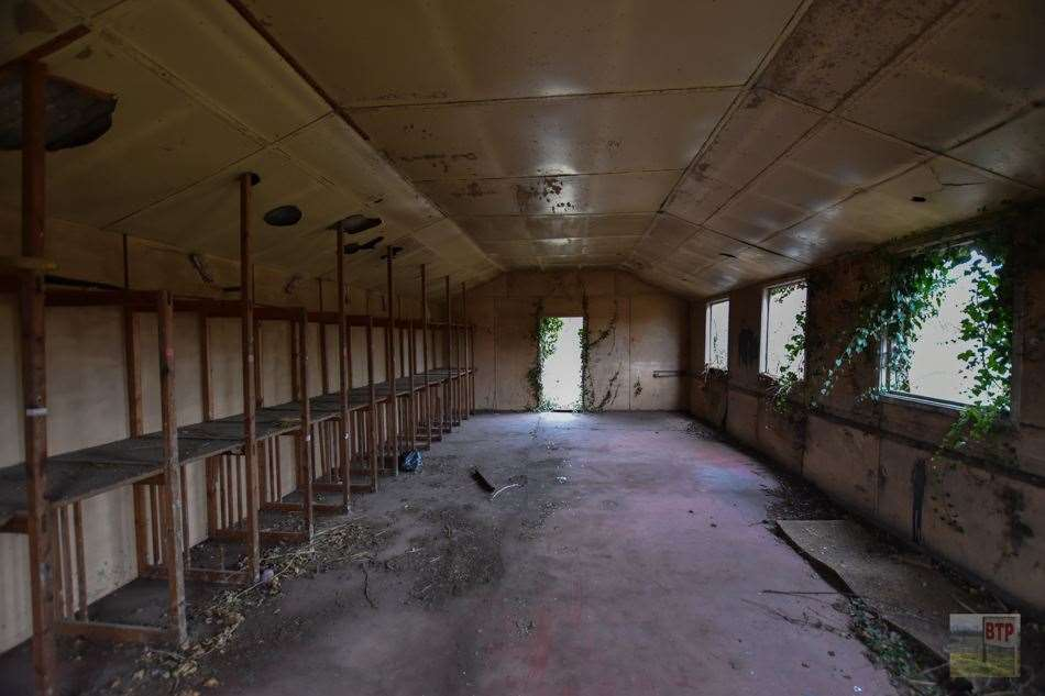 Inside one of the old decaying buildings where fireworks were once assembled. Photo: Beyond The Point (20798574)