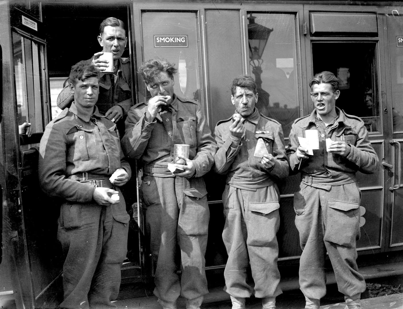 Members of the British Expeditionary Force with tea in cans from the canning factory
