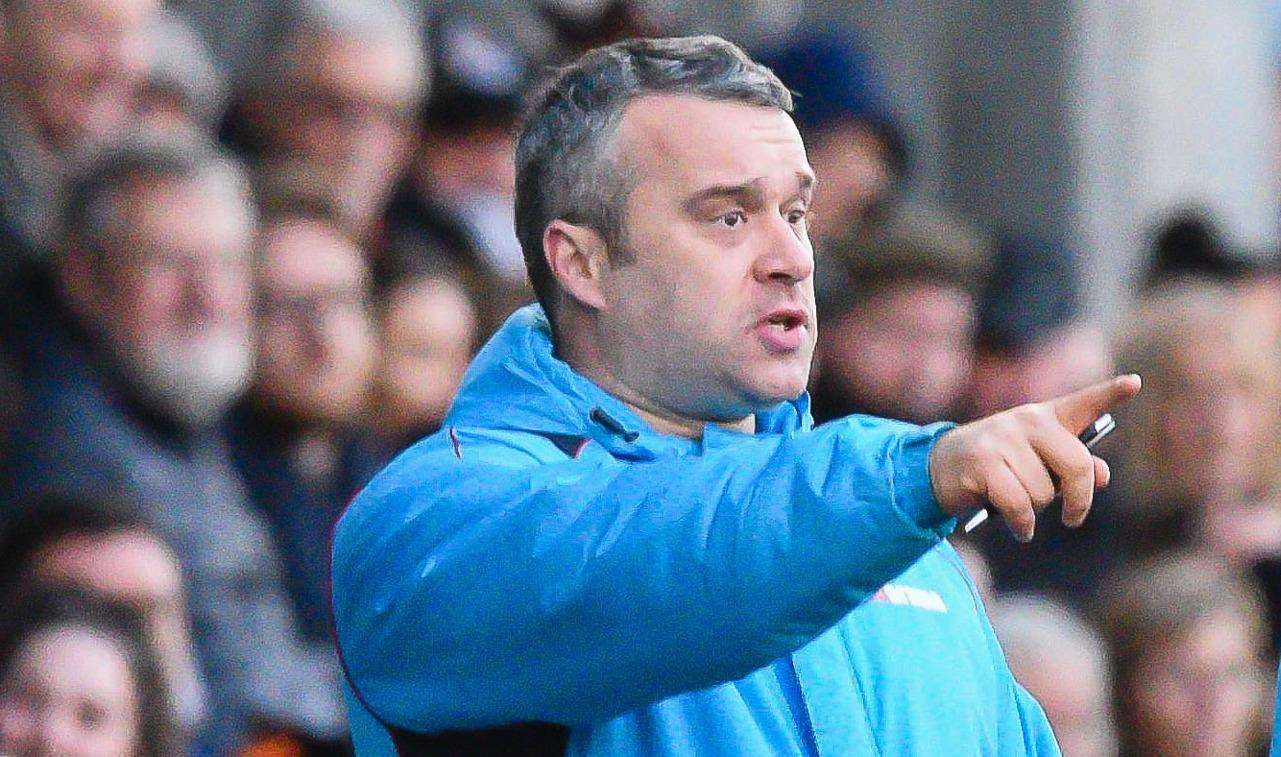 Dartford joint-manager Adam Flanagan makes his point on the sidelines. Picture: Alan Langley