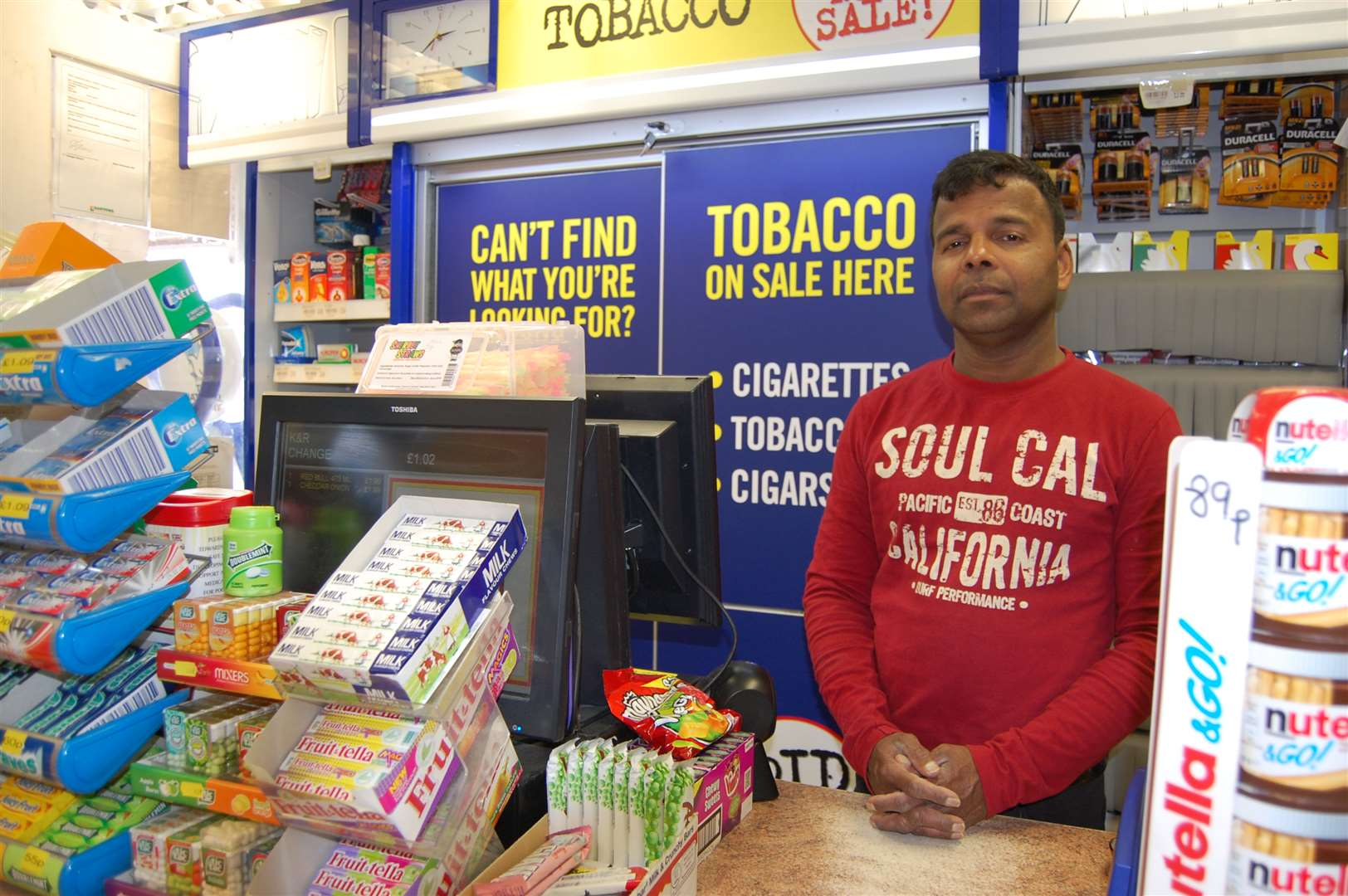 Kandasamy Sivanathan was forced to hand over hundreds of pounds from the shop's till.