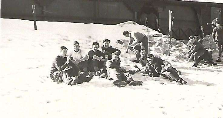 John Marsh and comrades sip ice cold beer lying on the snow in the Harz Mountains