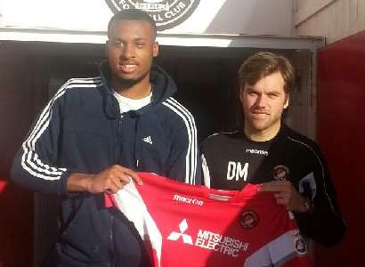 Reiss Greenidge pictured with Ebbsfleet boss Daryl McMahon after signing