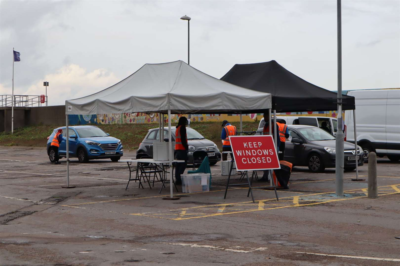 Three cars queuing for tests at the temporary coronavirus testing station in Beach Street, Sheerness, on Wednesday. Picture: John Nurden