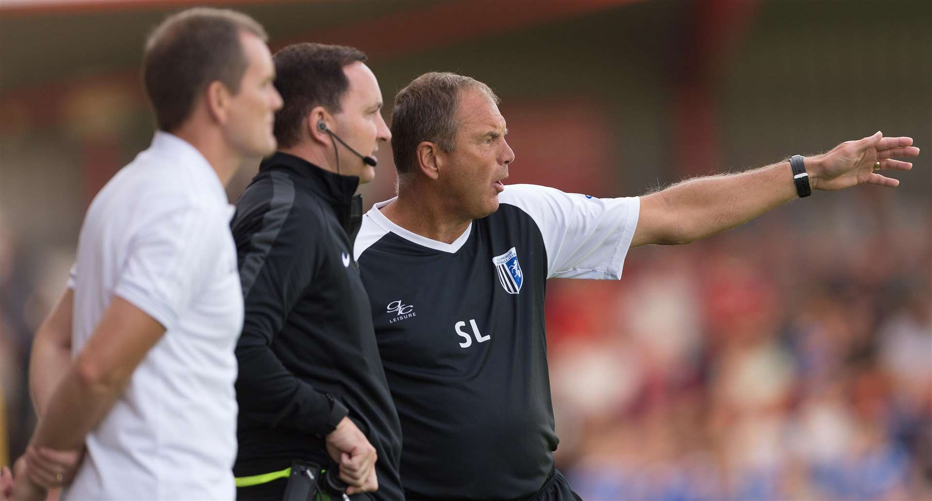 Gillingham boss Steve Lovell makes his point to fourth official Joe Johnson. Picture: Ady Kerry