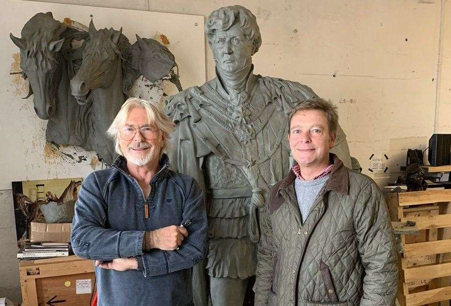 Craig Mackinlay being given a preview of Dominic Grant's sculpture of George IV