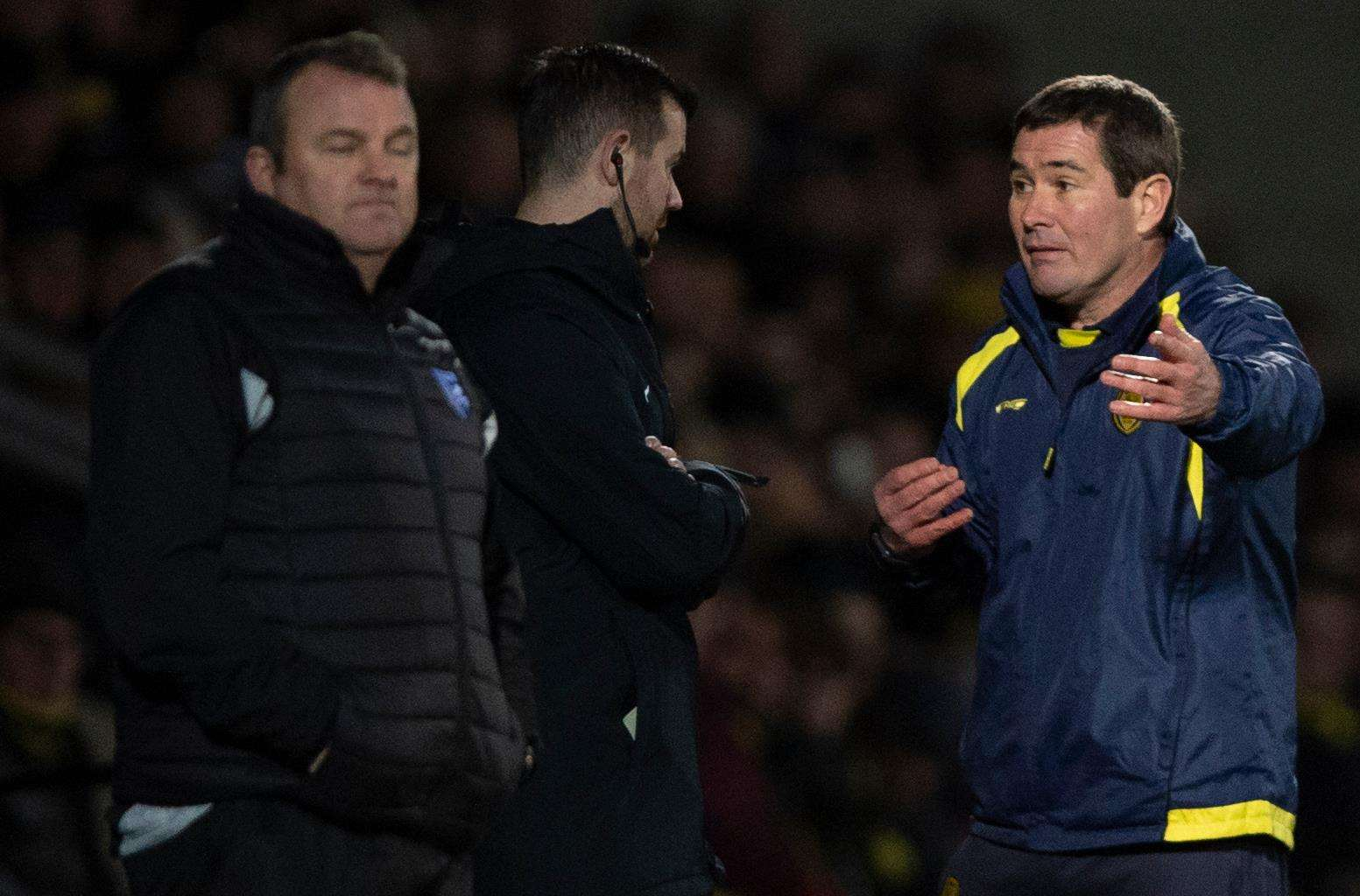 Burton manager Nigel Clough argues with the fourth official Picture: Ady Kerry