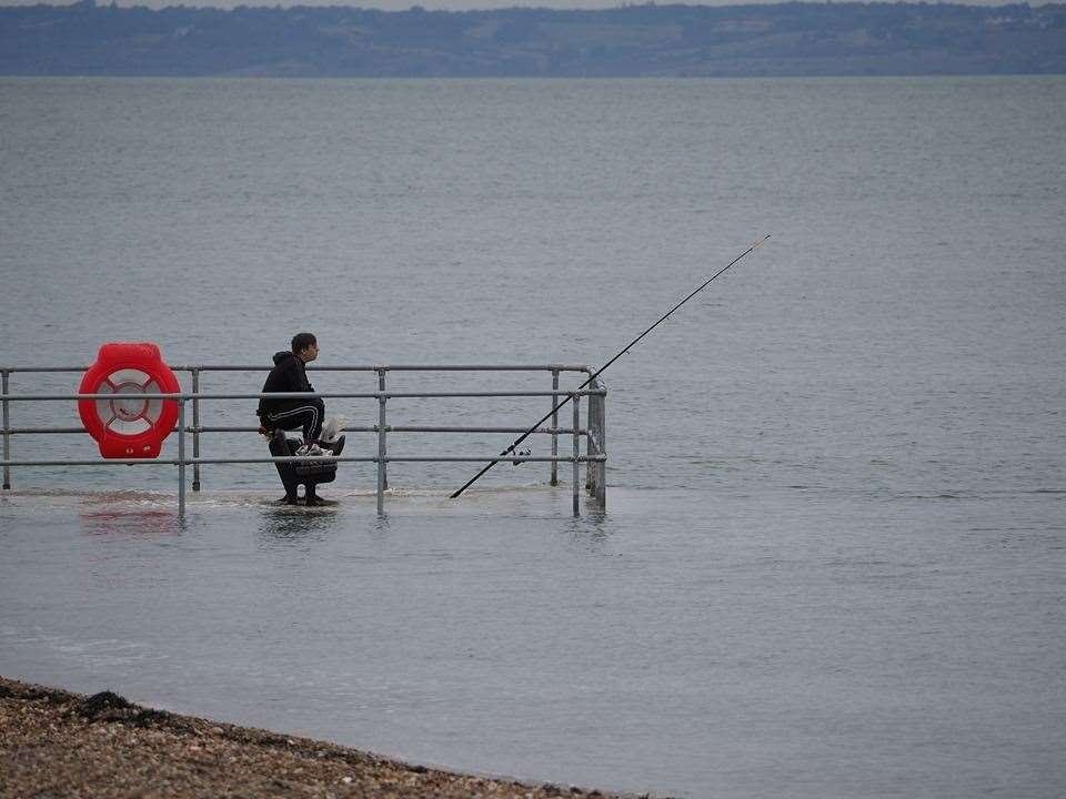 High tide fisherman at Neptune Jetty, Sheerness. Picture copyright James Bell