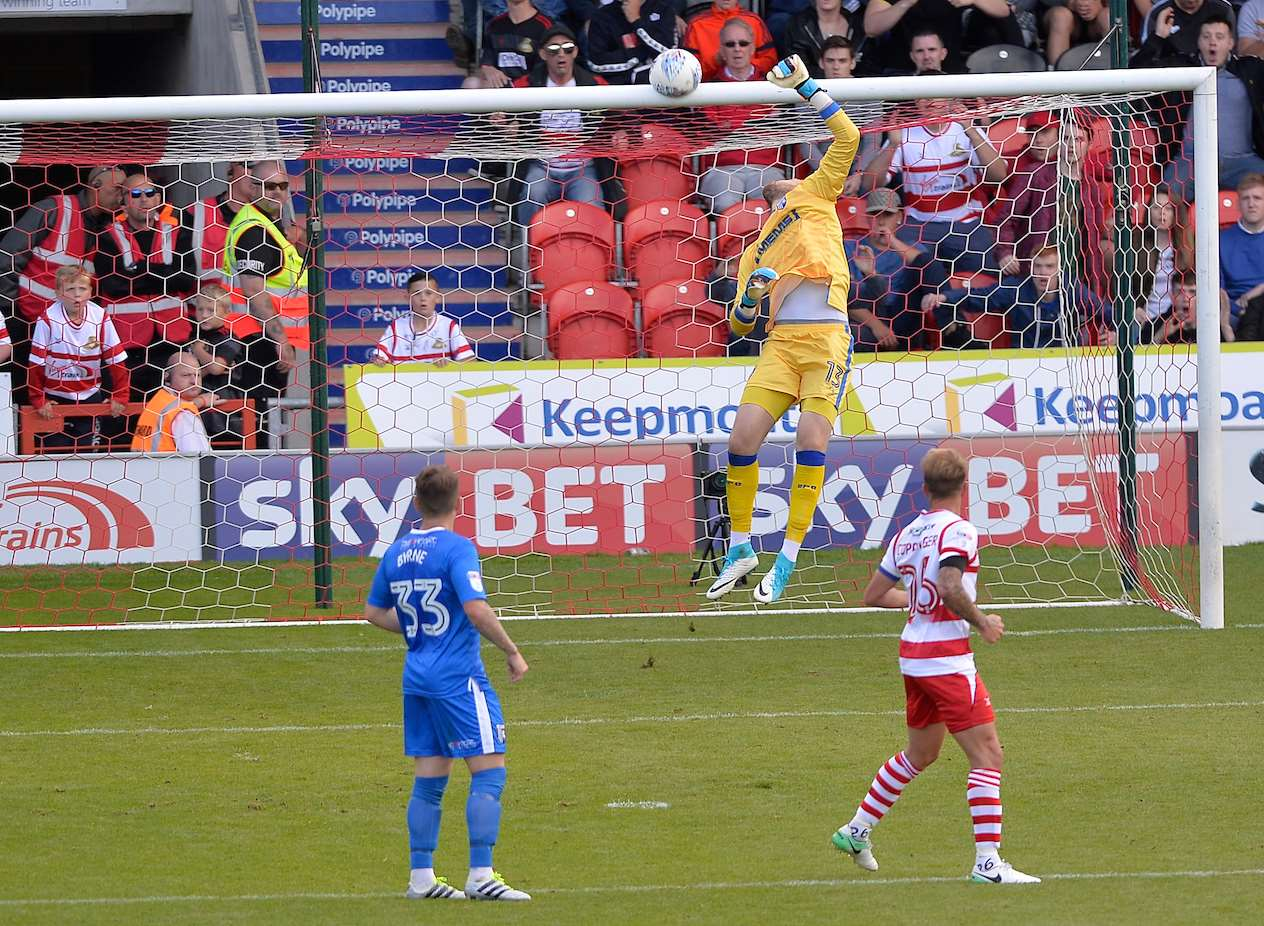 Ben Whiteman beats Gills keeper Tomas Holy but not the woodwork Picture: Ady Kerry
