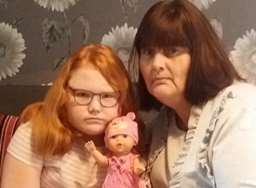 Abbie and her mum Sara were shocked by the doll's choice of words.