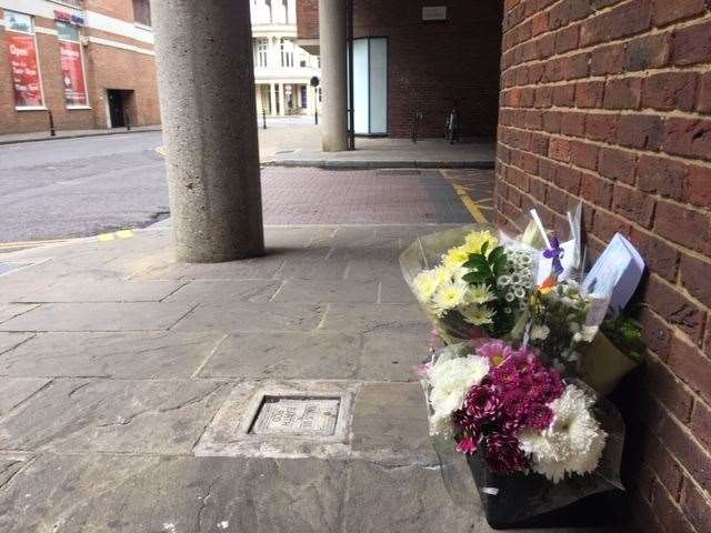 Flowers left by the scene of the attack in Rose Lane