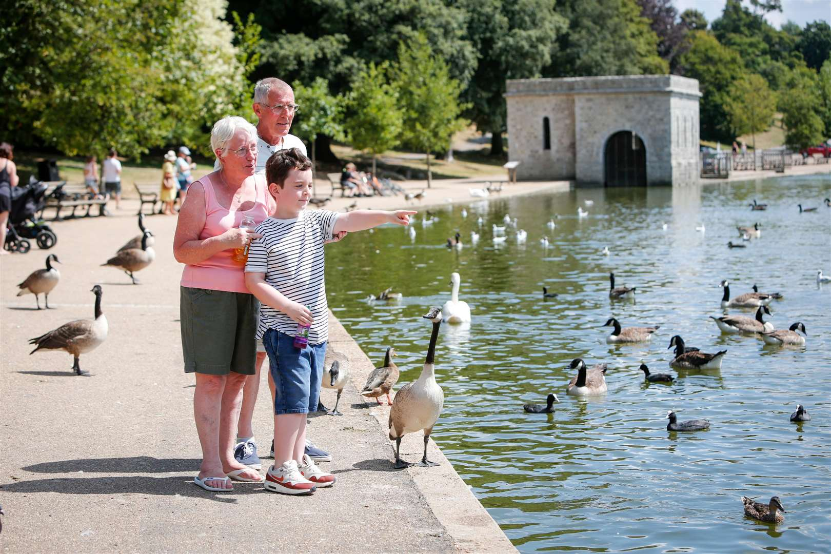 Visitors enjoy the sunshine at Mote Park in Maidstone. Picture: Matthew Walker