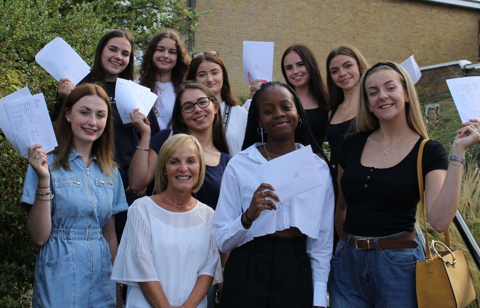 Invicta head teacher Julie Derrick with some of her Year 13 students