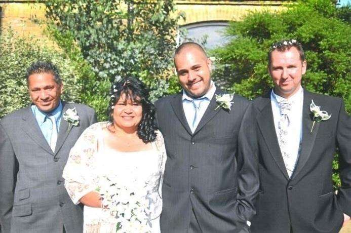 From left to Lionel, Christine, son Brynley and Shane on Christine's wedding day